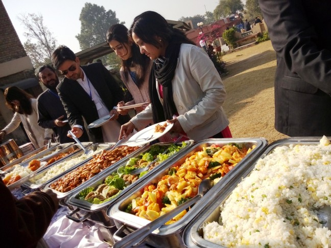 Pakistani people enjoying Chinese food at Lok Virsa in Islamabad.