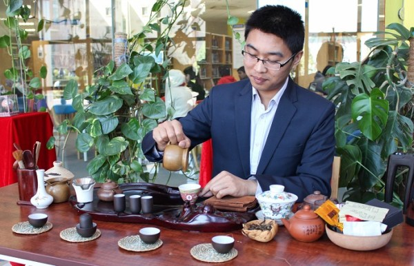 A man pouring traditional Chinese tea during China Culture Day event held at COMSATS University in Islamabad. Photo by Sana Jamal