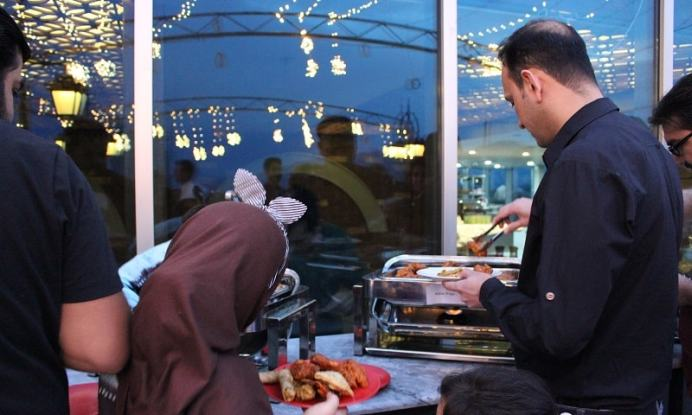 Visitors trying the Iftar food items at La Terrazza restaurant in Islamabad.