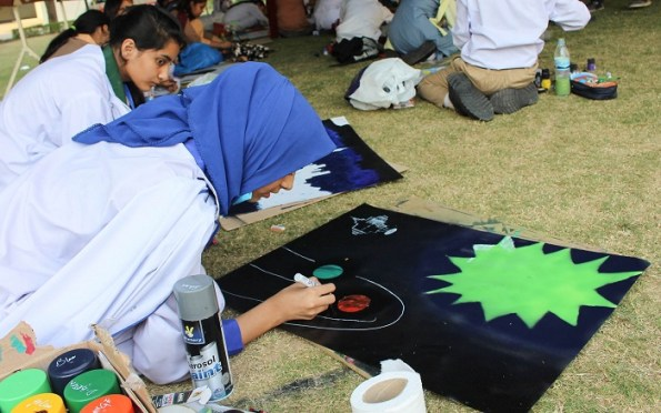 Students working on their artistic pieces at Space Fine Arts contest. Photo by Sana Jamal