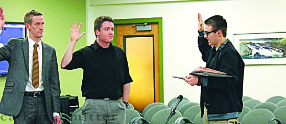 Incoming ASISU Vice President Jameson Bastow and new lobbyist Alex Eckman are sworn in during the regular ASISU senate meeting on Jan. 14.