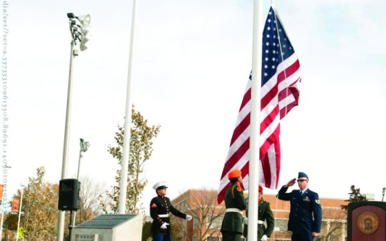 Raising the American flag over the Cadet Field memorial in 2012.