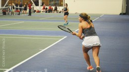 ISU women's tennis players on the court