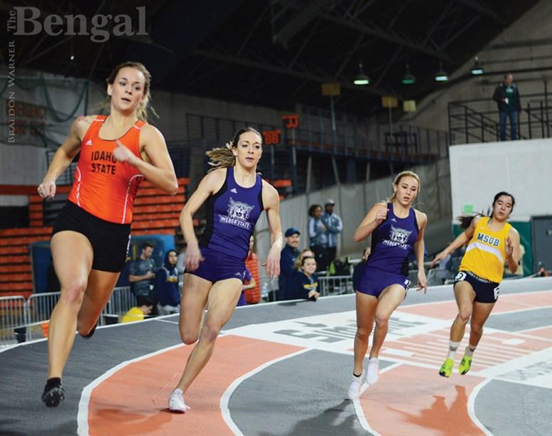 Women running on track.