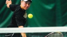 Josh Goodwin playing tennis.