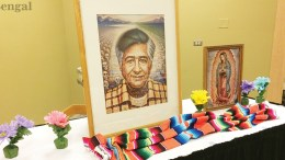 Table decorated with picture of Chavez and other decorations.