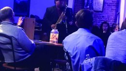 Dr. Libman playing saxophone at Portneuf Valley Brewery.