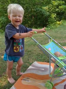 E pushing toy stroller, Camp NeeKauNis