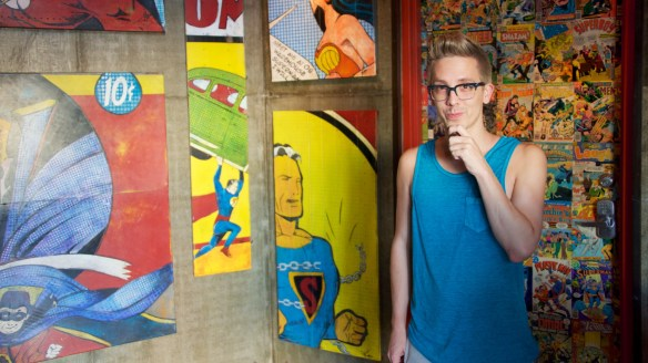 Cody Rodriguez standing in front of comic books in Ocean Beach San Diego