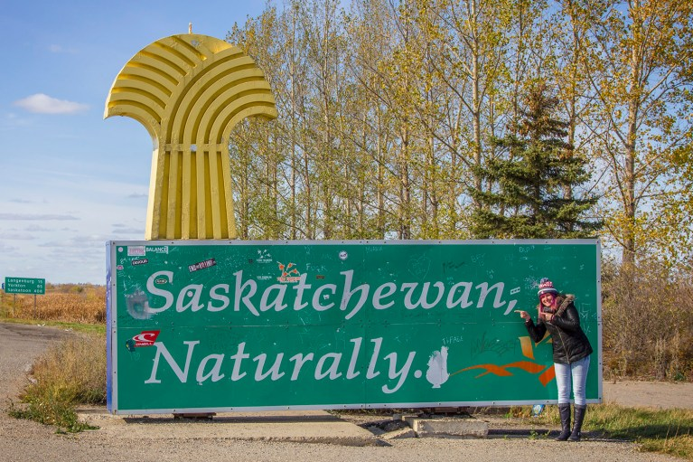 Posing with Saskatchewan Sign, Manitoba Road Trip - 7 Days of Canadian Prairie Adventure :: I've Been Bit A Travel Blog