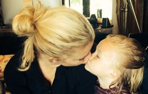 Jess Johnson with her daughter side view kiss