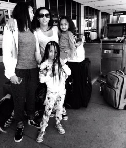 Mel B at the airport with her daughters and a loooot of luggage