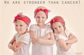 Three little girls re-create viral photo to celebrate cancer remission.