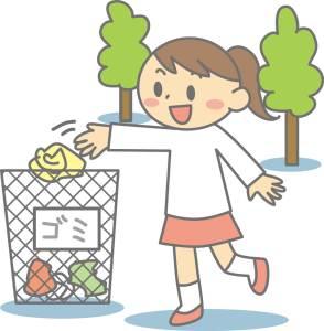 屋外でゴミ箱にゴミを捨てる女の子