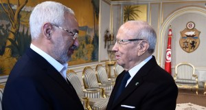 Tunisian President Beji Ceid Essebsi (R) shakes hands with Ennahdha Islamist party Leader Rached Ghannouchi during an event in Tunis on January 14, 2015, marking the fourth anniversary of the ousting of Tunisia's longtime ruler Zine el Abidine Ben Ali, that sparked the Arab Spring uprisings. On January 14 2011, under massive popular pressure over unemployment and inflation, Ben Ali fled to Saudi Arabia with his family after 23 years in power. AFP PHOTO/ FETHI BELAID        (Photo credit should read FETHI BELAID/AFP/Getty Images)