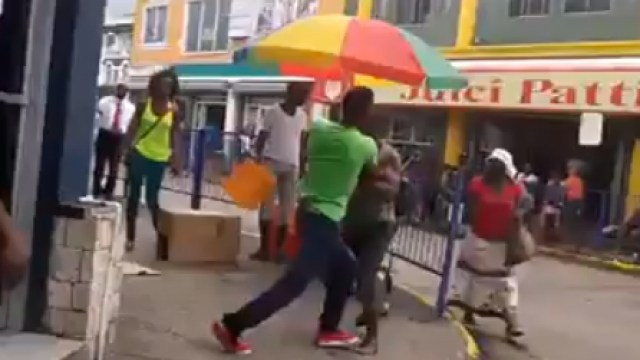 Two Men Fighting In Downtown Mobay