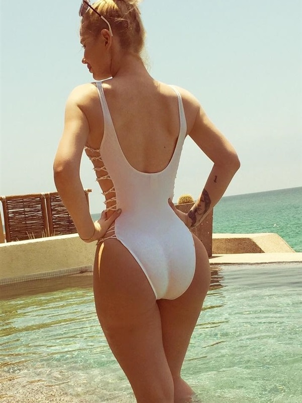 Show off her assets while wearing an all white swimsuit check it out
