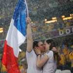 Fans of France kiss before their Group D Euro 2012 soccer match against Ukraine at Donbass Arena in Donetsk
