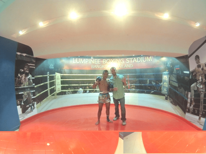Me posing with a pro Muay Thai Fighter at Lumpinee Stadium in BKK… I could probably take him