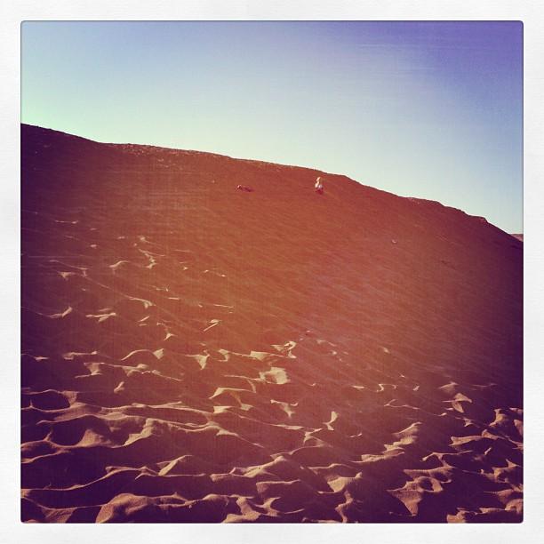 Rush scaling a massive dune...