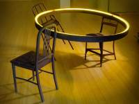 Table Dance, 7' x 7' x 3.5', argon glass tube, electronics, fabricated mild steel