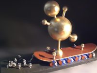 """Golden Boy with Tail, 30"""" x 12"""" x 24"""", fabricated mild steel, cast pewter, wood, found objects, L.E.D. lighting, gold leaf, flocking"""