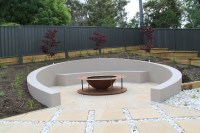 Sunken circular seating area with fire pit | Janna ...