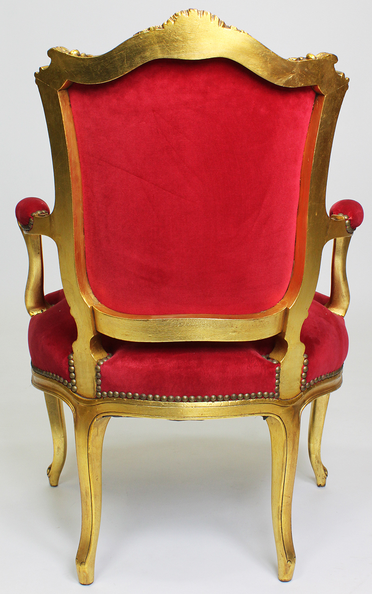 A Pair Of French Louis Xv Style Giltwood Ccarved Rococo Fauteuils Armchairs The Intricately Carved Wood Frames With Open Scrolled And Padded Armrests And Cabriolet Legs Upholstered In A Red Velvet Circa