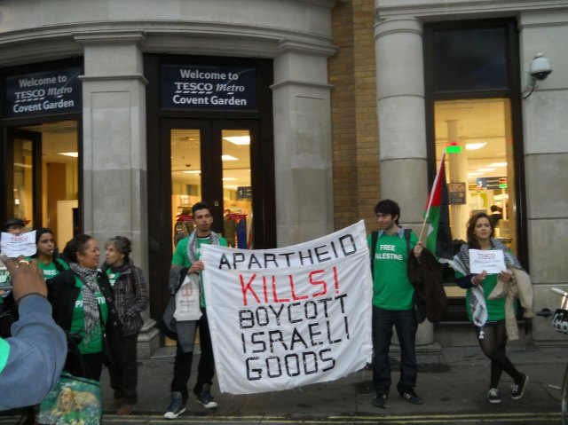 BDS mobs converge on Tesco supermarket in UK during a day of BDS protest in 2011. BDS activists raided stores and deshelved Israeli goods while demonstrators drew attention outside.