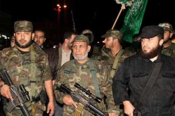 Mahmoud al-Zahar (center), a Hamas co-founder, minimizes the distinction between Hamas' political and military wings.