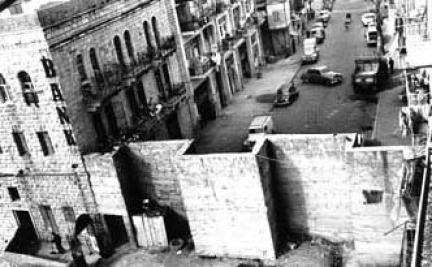 A wall in the heart of a city. Jaffa Road in downtown Jerusalem was divided by a wall for a 19-year span—1948-1967. From time to time Jordanian Legionnaires sniped at Jewish residents. (Courtesy of the Municipal Archives of Jerusalem)