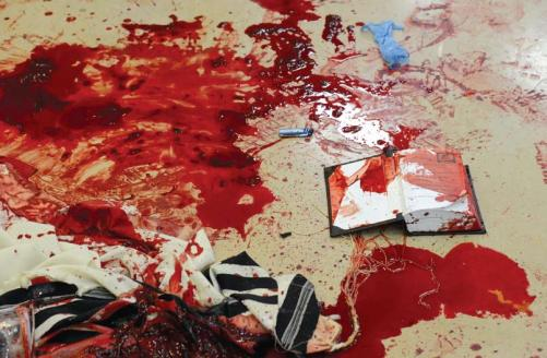Scene of the terror attack on the synagogue in Har Nof, Jerusalem, November 18, 2014. Prayer shawls and holy books are stained with blood. Two terrorists murdered four worshippers and a policeman. East Jerusalem residents' participation in terror has grown in recent years, but thanks to Israeli security control of the Arab neighborhoods hundreds of attacks have been thwarted and only dozens have been perpetrated. (Photograph: Koby Gidon, Flash 90)