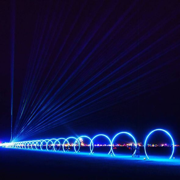The Sonic Runway, my favourite installation this year.  32 separate rings of light that change colour depending on the music being played at the start of the line.  It would be in sync with how fast the music travels.