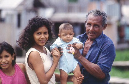 Girl and Man Holding Baby, Relationships Unclear, in Manaus