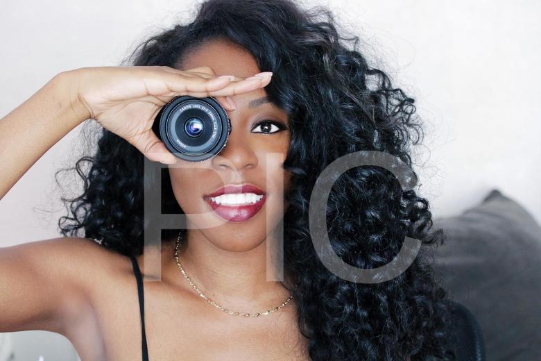 Girl-Holding-Camera-Lens-Over-Eye-Small