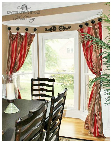 Bay window treatments that won 39 t break your budget for Bay window dressing ideas
