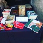 My stash of books at the SCBWI booth