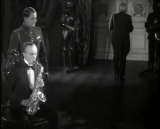 What better way to demonstrate a mechanical man to cigar-smoking bigwigs than to control it by saxophone?