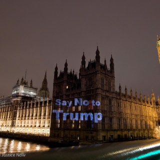 'Say no to Trump' projected on Parliament by Global Justice Now and Feral X ahead of Trump debate and #stopTrump protests, Westminster, London.  © Jess Hurd/Global Justice Now