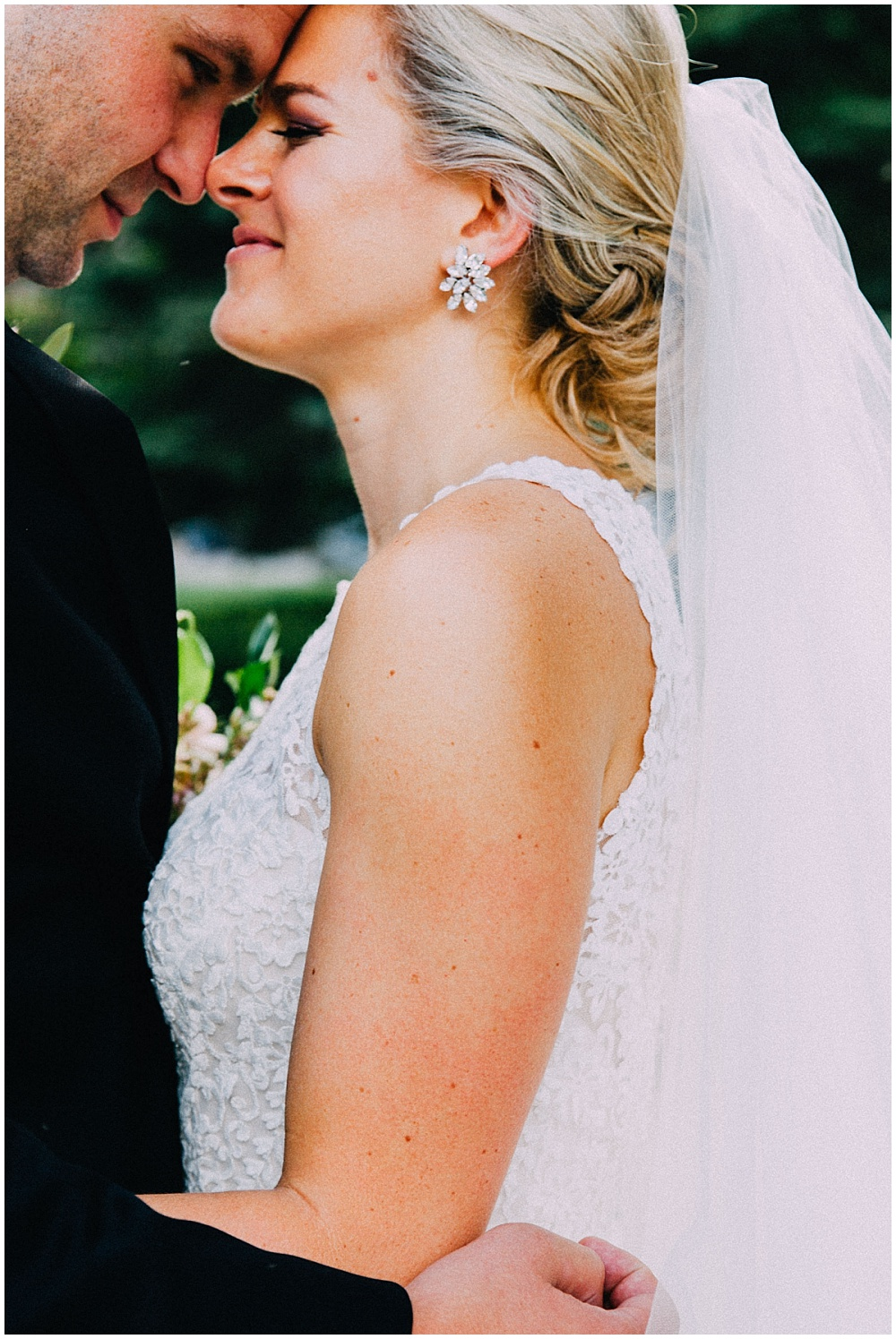 Bride and Groom; lace wedding dress and blingy earrings | Downtown Indianapolis Wedding by Caroline Grace Photography & Jessica Dum Wedding Coordination