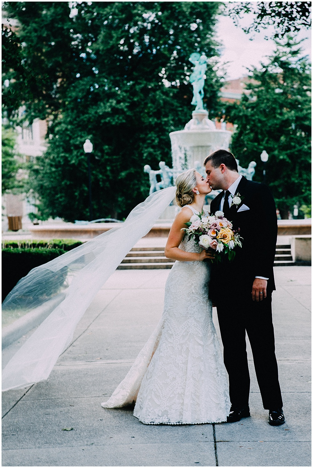 Bride and Groom, and summer wedding bouquet | Downtown Indianapolis Wedding by Caroline Grace Photography & Jessica Dum Wedding Coordination
