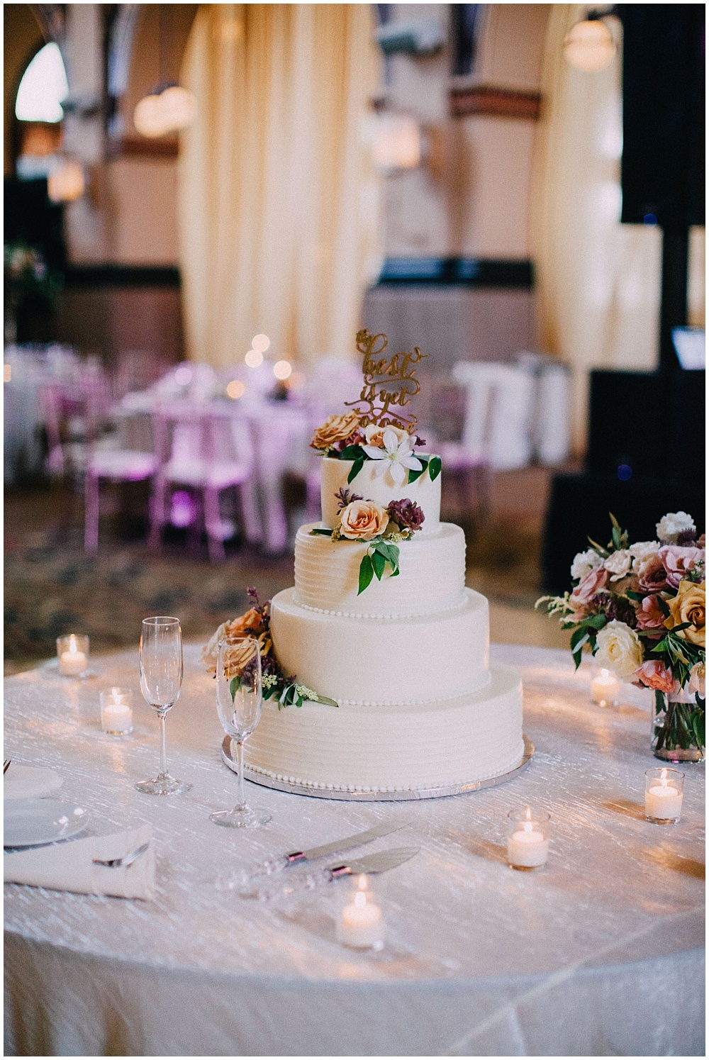 White wedding cake with simple flowers | Downtown Indianapolis Wedding by Caroline Grace Photography & Jessica Dum Wedding Coordination
