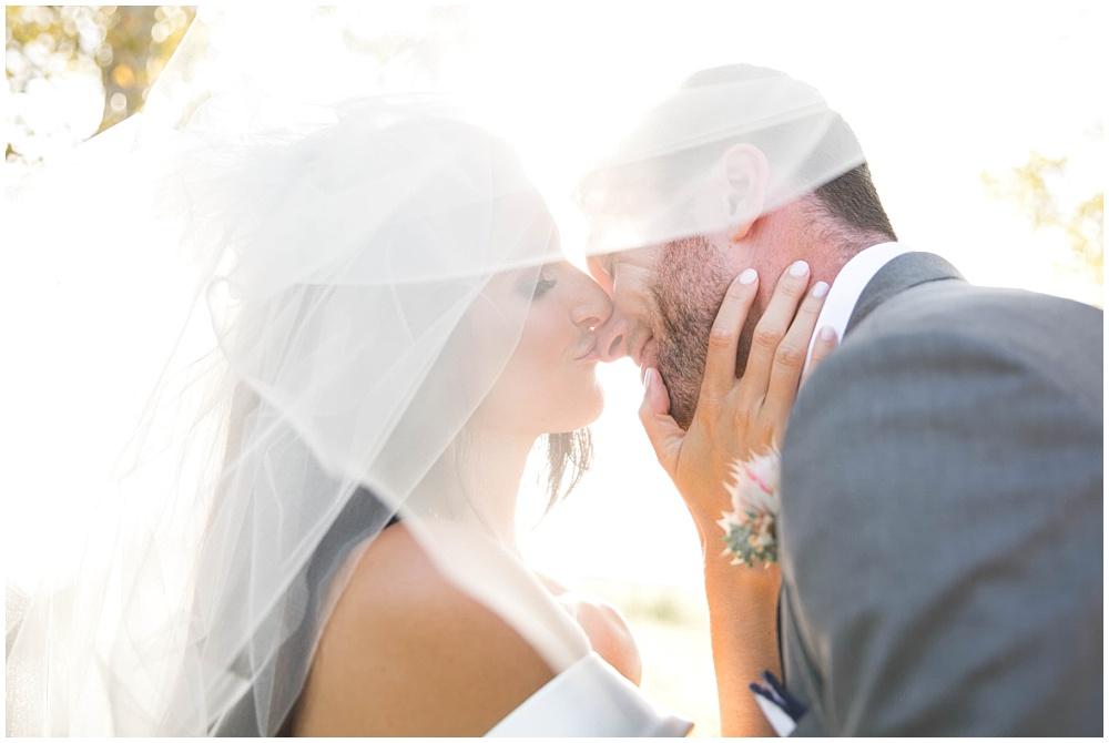 Bride and Groom portrait under her veil | Family Farm wedding by SB Childs Photography & Jessica Dum Wedding Coordination