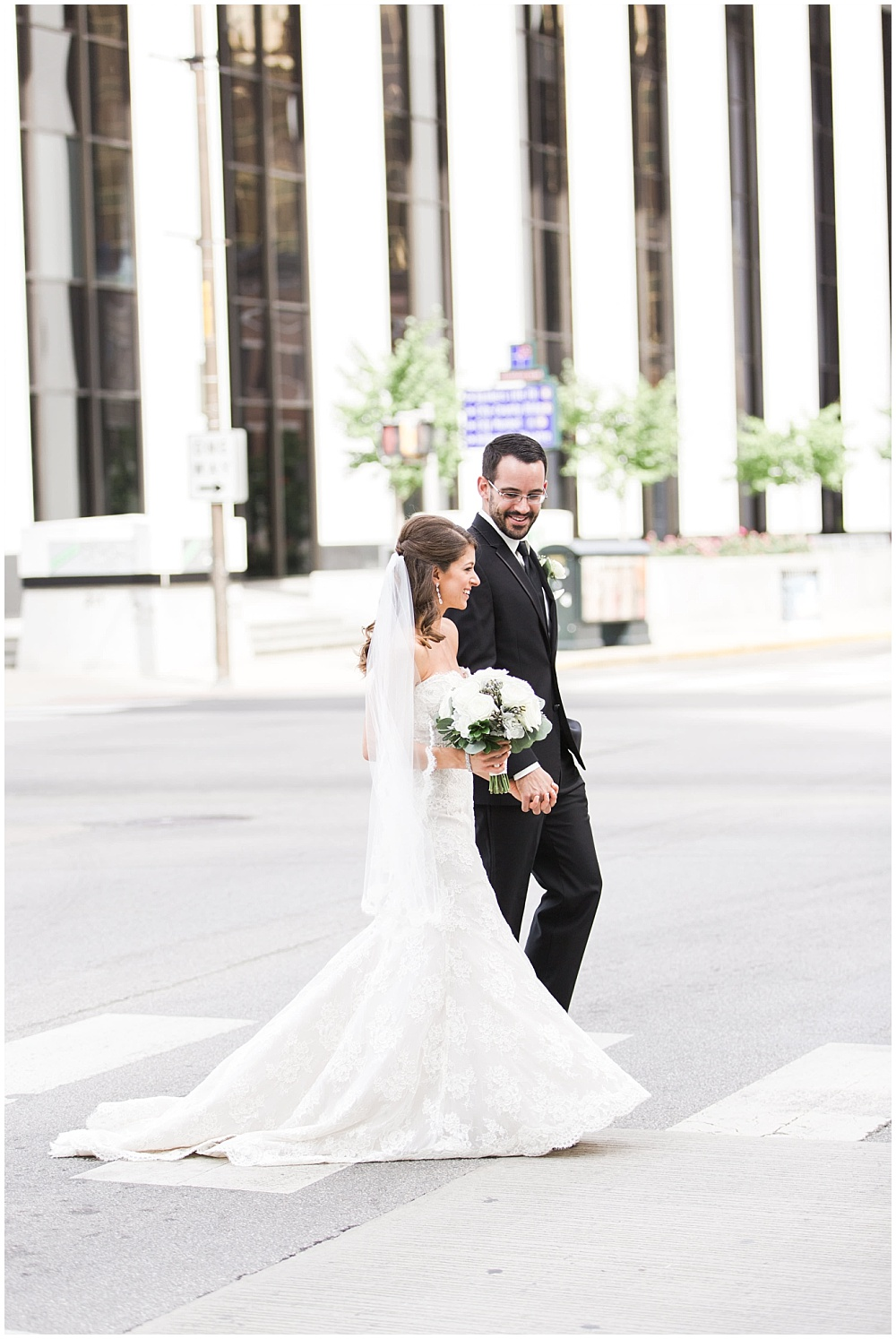 Bride and Groom walking through downtown streets | D'Amore Wedding by Ivan & Louise Images & Jessica Dum Wedding Coordination