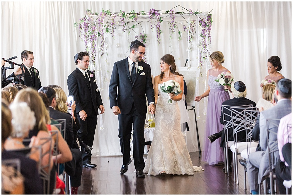Jewish wedding ceremony with hanging floral chuppah | D'Amore Wedding by Ivan & Louise Images & Jessica Dum Wedding Coordination