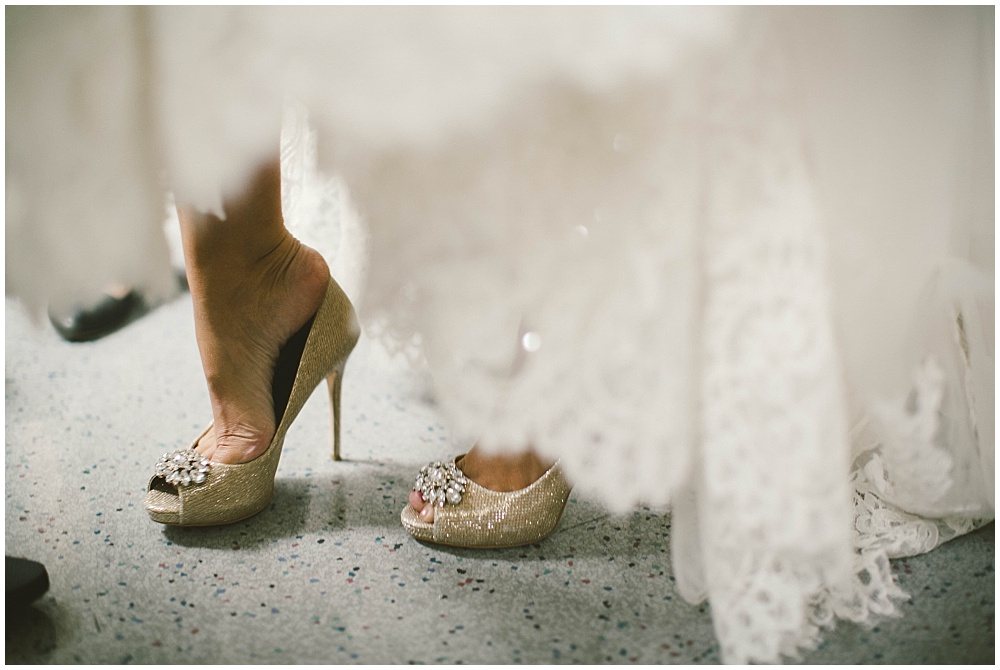 Bride getting into her shoes | Indianapolis Central Library Wedding by Jennifer Van Elk Photography & Jessica Dum Wedding Coordination