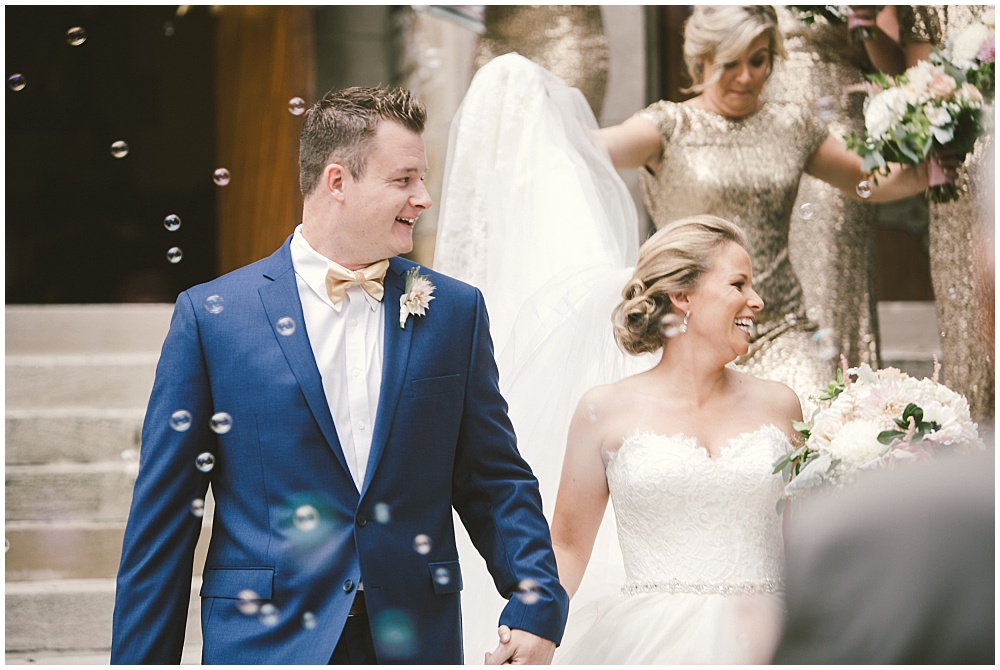 Bride and Groom church bubble exit | Indianapolis Central Library Wedding by Jennifer Van Elk Photography & Jessica Dum Wedding Coordination