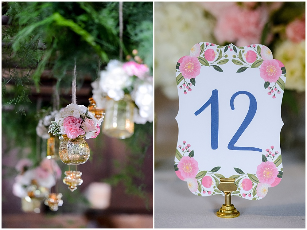 Hanging wedding flowers in gold jars and watercolor floral table numbers | Mustard Seed Gardens Wedding by Sara Ackermann Photography & Jessica Dum Wedding Coordination