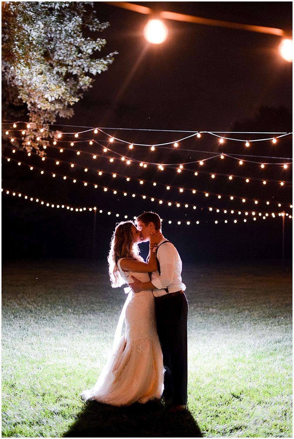 Bride and Groom under a canopy of lights | Mustard Seed Gardens Wedding by Sara Ackermann Photography & Jessica Dum Wedding Coordination
