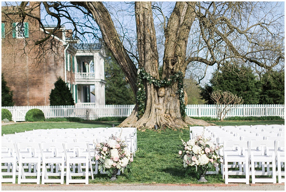 tree with draped garland ceremony space, navy and pink southern wedding | Ivan & Louise Images and Jessica Dum Wedding Coordination
